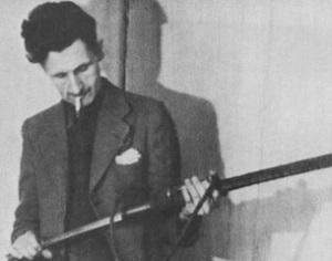 George Orwell med gevær og sigarett